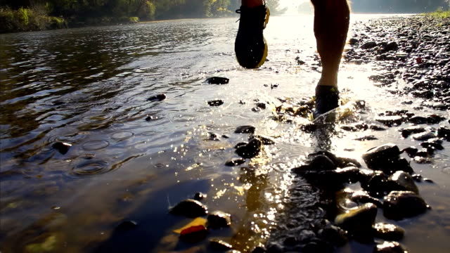 HD SUPER SLOW-MO: Runner's Footwear Splashing Water