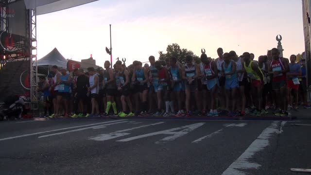 runners head out from grand army plaza at the entrance to prospect park in the brooklyn half marathon - salmini stock videos & royalty-free footage