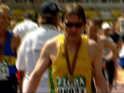 runners in 2007 london marathon competitor being wheeled off on stretcher by st john's ambulance volunteers more of competitors after race including... - exhaustion stock videos & royalty-free footage
