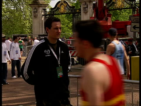 runners in 2007 london marathon; the mall: exhausted runners walking along after race, including some limping or bending over, some seated on tarmac - bending over stock videos & royalty-free footage