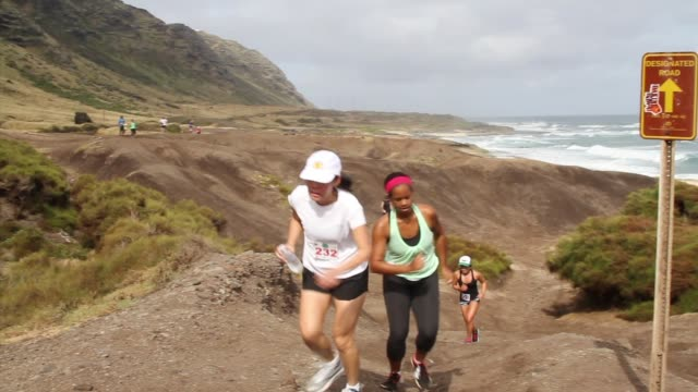 Runners in Keana Point Run in Oahu Hawaii Trail Run Pacific Ocean very close Six shots Split audio tracks voice over for reference