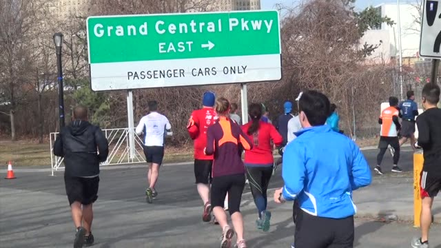 runners in queens half marathon runners appear to be going to the the grand central parkway - salmini stock videos and b-roll footage