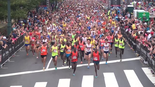 runners in road race in philadelphia start and finish in front of philadelphia museum of art thousands start race - salmini stock videos & royalty-free footage