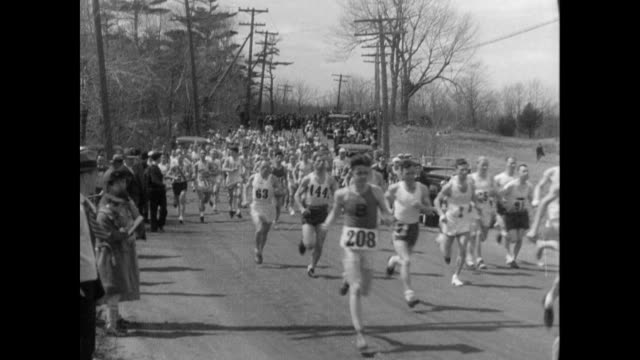 / runners in the boston marathon / clarence demar noted / john kelley wins john a kelley wins boston marathon on april 25 1935 in boston massachusetts - 1935 stock videos & royalty-free footage