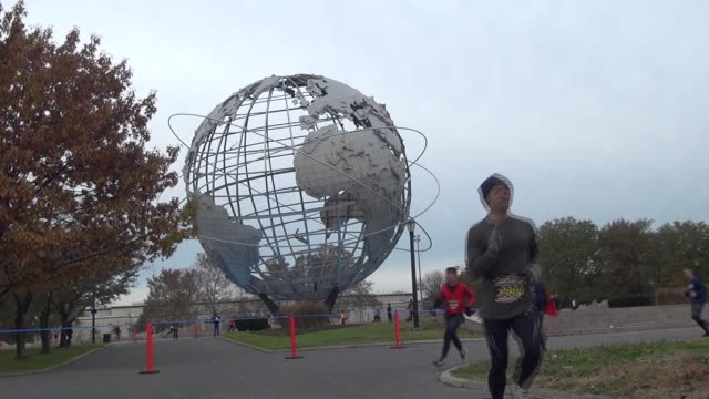 runners on course in queens half marathon in corona park by unisphere - salmini stock videos & royalty-free footage