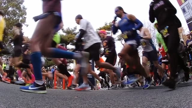 runners on course in queens half marathon in corona park start low angle slow motion - salmini stock videos and b-roll footage