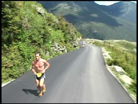 runners on high mountain road ascending from mt washington road race runners on high mountain ascending on july 15 2010 - salmini stock videos and b-roll footage