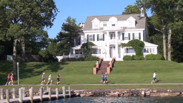 runners on waterfront path along long island sound shelter island - salmini stock videos & royalty-free footage