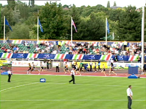 runners race around a track in the men's 1500m final - men's track stock videos and b-roll footage