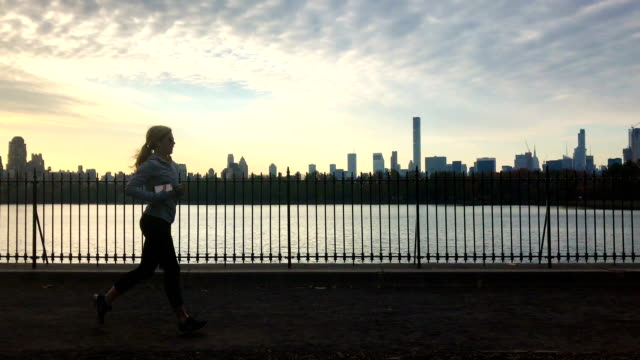 runners running in central park arounf jacqueline kennedy onassis reservoir in new york city usa - central park reservoir stock videos and b-roll footage