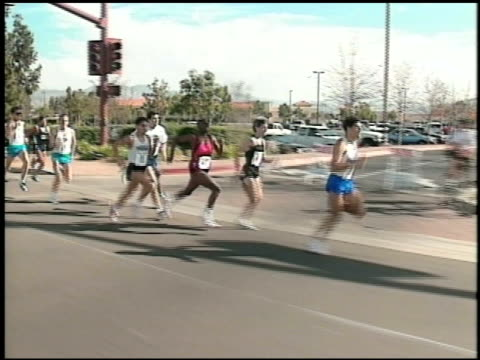 runners sprint last 100 yards of race runners sprint last 100 yards of race on january 01 2012 - salmini stock videos and b-roll footage