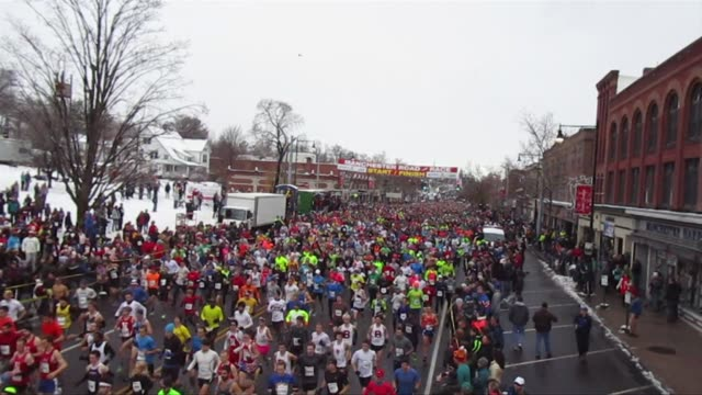 runners start in distance and head toward camera and fill street000 runners manchester road race on thanksgiving day - salmini stock videos & royalty-free footage