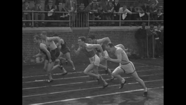 mo runners take off from starting blocks to begin the 100 meter dash crowd looking on from the stands in background / mcu starter john mchugh with... - hahnenschrei stock-videos und b-roll-filmmaterial