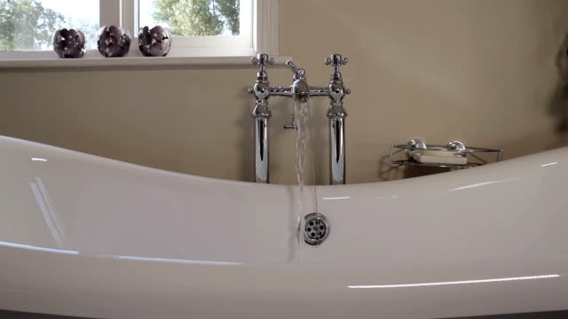 running a warm soothing bath - running water stock videos & royalty-free footage