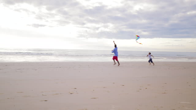 running after a kite - single father stock videos & royalty-free footage