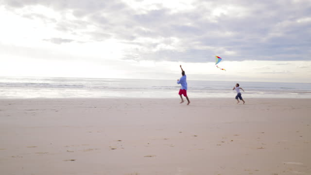 running after a kite - northumberland coast stock videos & royalty-free footage