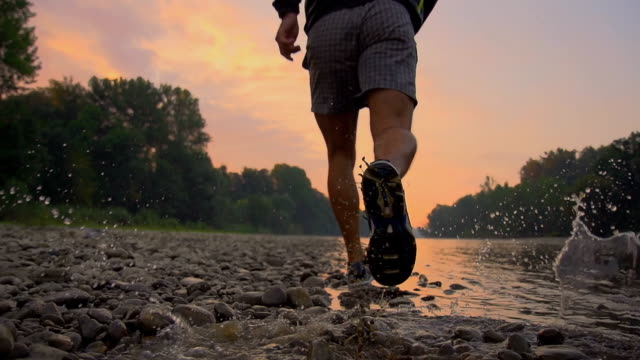 hd super slow-mo: running along the river - human foot stock videos and b-roll footage