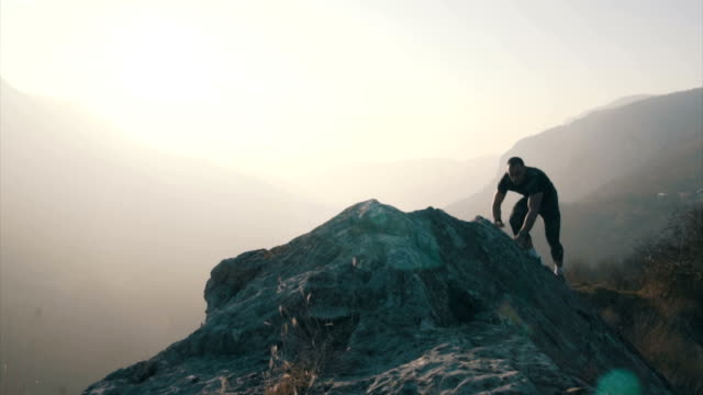 running and jumping on the rocks - pursuit sports competition format stock videos & royalty-free footage
