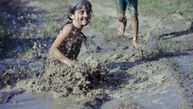 running and jumping - mud stock videos & royalty-free footage
