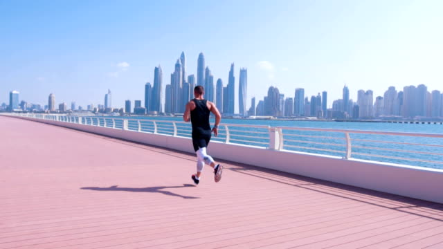 running at dubai marina - dubai stock videos & royalty-free footage