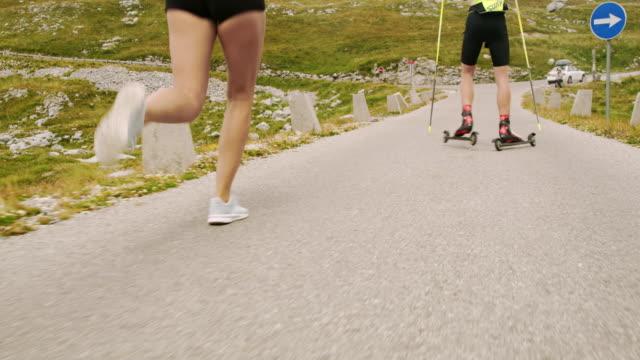 stockvideo's en b-roll-footage met slo-mo running achter een persoon roller skiën in de bergen - julian alps