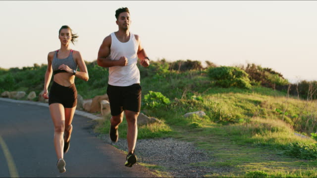 running can be fun when you run together - wellbeing stock videos & royalty-free footage