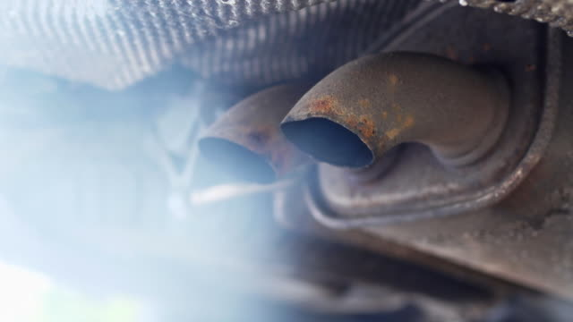 Running Car Exhaust Gases Close-up