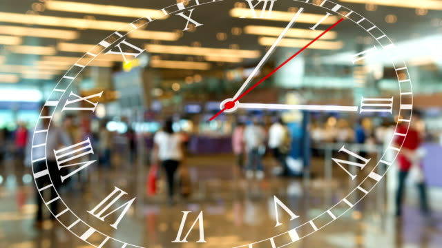 running clock with busy airport passenger terminal - minute hand stock videos & royalty-free footage