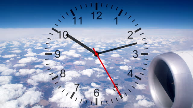 Running Clock with Cloudscape from Air Plane Window View