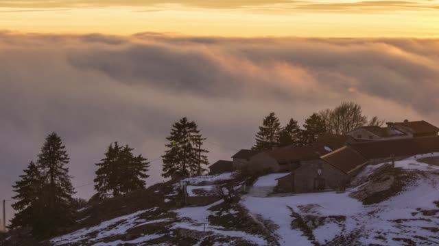 running clouds with a chalet at sunset time - chalet stock videos & royalty-free footage