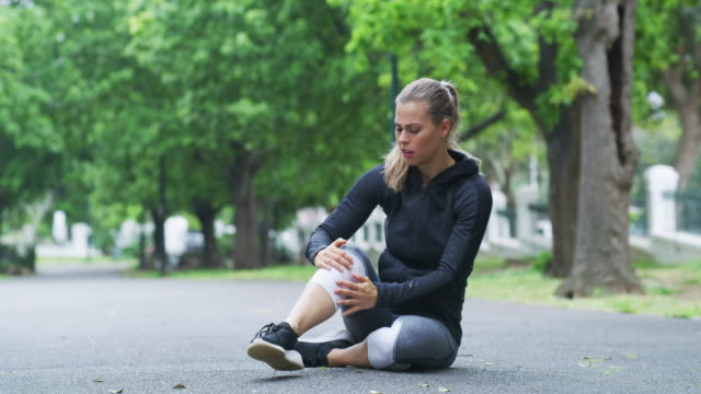 running comes with some risks - pain stock videos & royalty-free footage