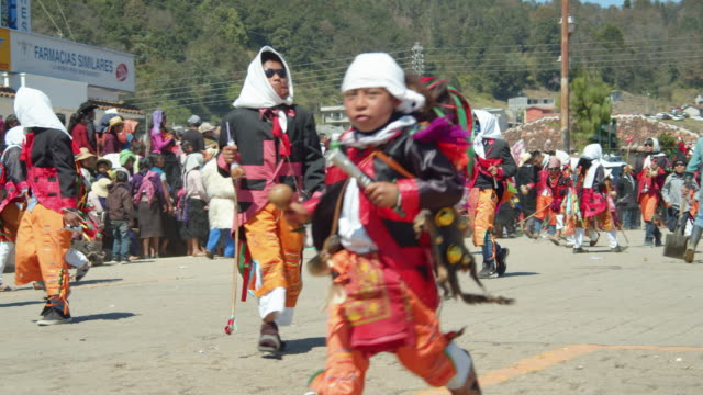 running during traditional carnival parade at san juan chamula, chiapas, mexico. syncretism tradition - north american tribal culture stock videos & royalty-free footage