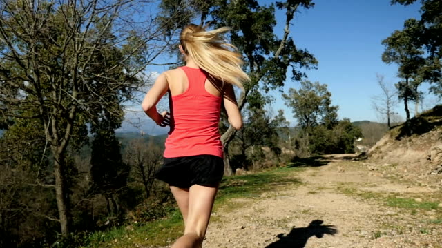 running in beautiful nature - running shorts stock videos and b-roll footage