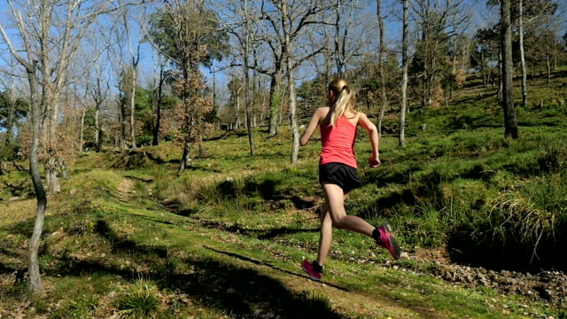 running in forest with long jumps - running shorts stock videos & royalty-free footage