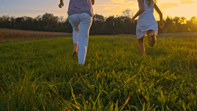 SLO MO Running In Grass At Sunset
