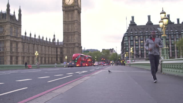 running in london is amazing - double decker bus stock videos & royalty-free footage