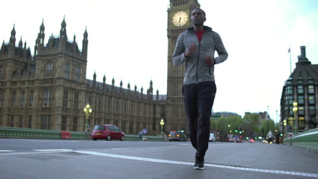 running in london - big ben stock videos & royalty-free footage