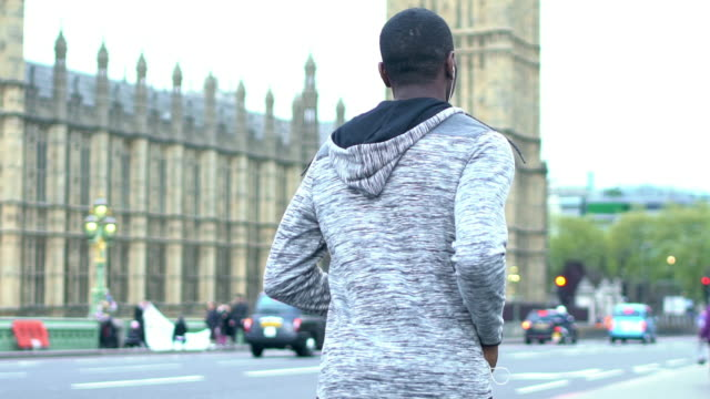 running in london - one man only stock videos & royalty-free footage