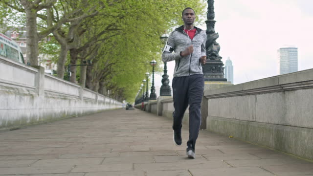 running in the city - one man only stock videos & royalty-free footage