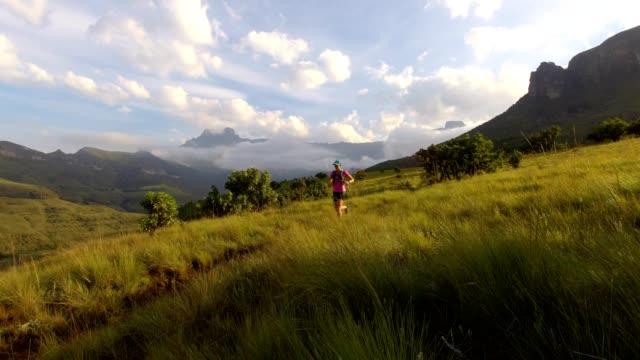 running in the mountains - drakensberg mountain range stock videos & royalty-free footage