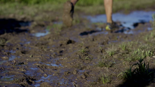running in the mud - superwoman stock videos and b-roll footage
