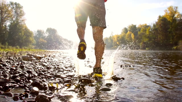 hd super slow-mo: running in the river - extreme terrain stock videos & royalty-free footage