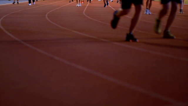 running, jogging and walking in sport running track - mack2happy stock videos and b-roll footage