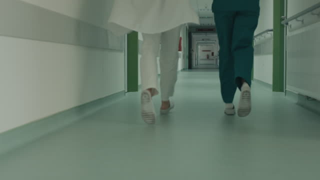 running legs in hospital corridor - healthcare and medicine stock videos & royalty-free footage