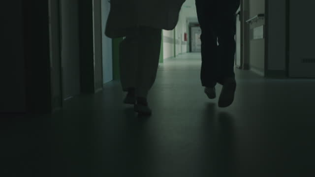 running legs in hospital corridor - slow-motion stock videos & royalty-free footage
