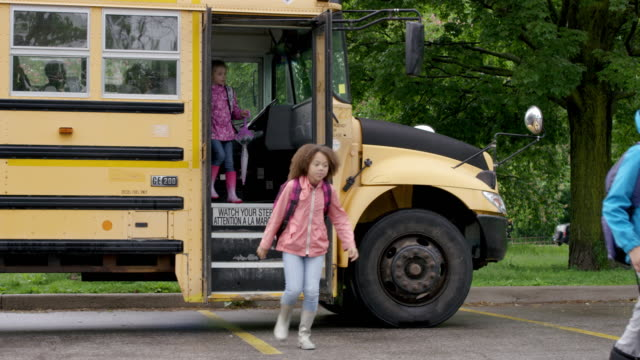 running off the school bus - school building stock videos & royalty-free footage