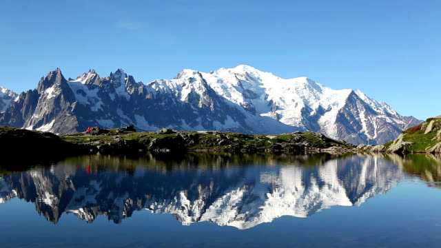 running on the edge of a lake in the alps - mont blanc stock videos & royalty-free footage