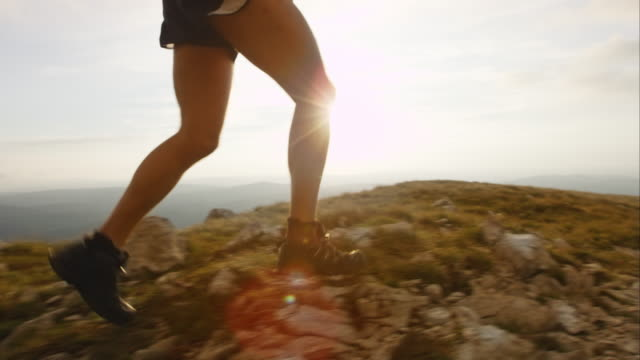 ts slo mo running on the mountain at sunset - mature men stock videos & royalty-free footage