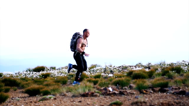 running on the rocky mountain - shirtless stock videos & royalty-free footage