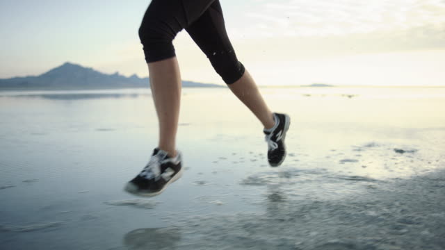 slo mo 4k: running on the salt flats - bonneville salt flats stock videos & royalty-free footage